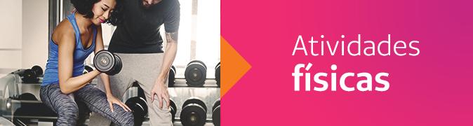 Atividades físicas - Mulher com halter na mão dentro da academia